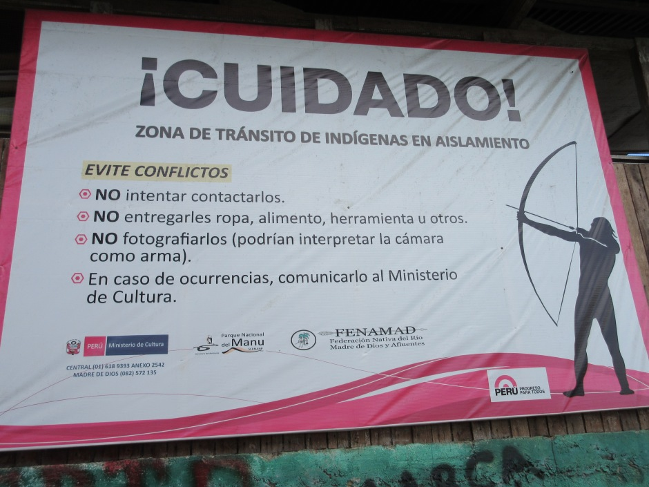 This sign, posted near the endof the cultural zone, says: don't attempt to contact the natives, give them things, photograph them (they may interpret your camera as a weapon), and report any occurences to government.
